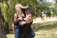Smiling piggyback girl on back Royalty Free Stock Image