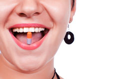 Smiling with pill in mouth Royalty Free Stock Image