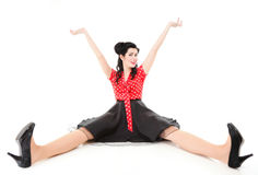 Smiling pin up girl sitting on floor  Royalty Free Stock Photo