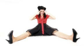 Smiling pin up girl sitting on floor isolated Stock Photography