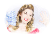 Smiling pinup cleaner with retro hair and makeup Royalty Free Stock Photography