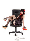 Smiling pinup girl in office armchair Royalty Free Stock Photos
