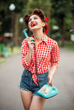 Smiling pinup girl with retro rotary phone Royalty Free Stock Photo