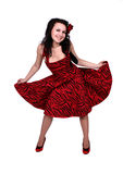 Smiling pinup girl standing in studio Stock Photography