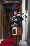 Smiling piper, Scotland Royalty Free Stock Images