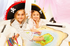 Smiling pirates drawing the map of Treasure Island Stock Photography