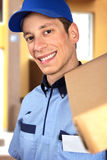 Smiling pizza delivery man holding pizza box Stock Photography