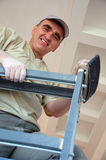 Smiling plasterer on ladder Royalty Free Stock Images
