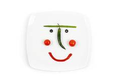 Smiling plate with a vegetable mug Royalty Free Stock Image