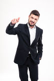 Smiling playful bearded businessman standing and pointing on you Stock Images