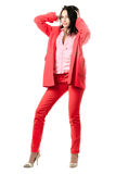 Smiling playful young brunette in red suit Stock Image