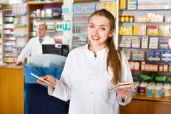 Smiling pleasant female pharmacist posing Stock Photo