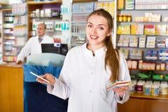 Smiling pleasant female pharmacist posing Stock Photo
