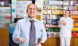 Smiling pleasant glad pharmacist and pharmacy technician Royalty Free Stock Photo