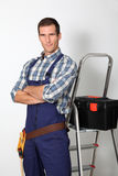 Smiling plumber Stock Images