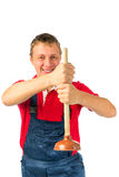 Smiling plumber with plunger Stock Photo