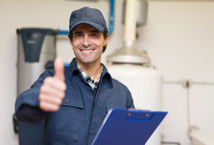 Smiling plumber portrait thumbs up royalty free stock photo