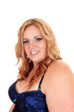 Smiling plus size blond woman. Stock Images