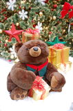 Smiling Plush Christmas Bear with Gift Stock Photography