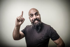 Smiling pointing bearded man Royalty Free Stock Image