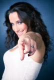 Smiling pointing woman. Focus on hand Stock Photos