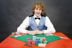 Smiling poker dealer Royalty Free Stock Photo