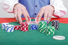 Smiling poker dealer Stock Images
