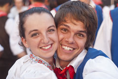 Smiling poland folk couple. POLIZZI GENEROSA, SICILY-AUGUST 21: Poland folk group at the International Festival of hazelnuts, smiling couple :August 21, 2011 in royalty free stock photo