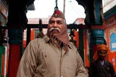 Smiling policeman guarding the hindu temple Stock Photo