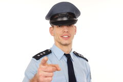 Smiling policeman shows on you. Stock Photography