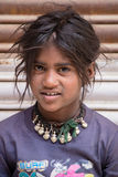 Smiling poor girl begs for money from a passerby on the street in Leh, Ladakh. India Stock Photos