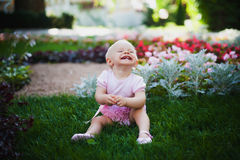 Smiling portrait cute baby-girl on green grass Royalty Free Stock Images