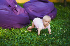 Smiling portrait cute baby-girl on green grass Stock Photo