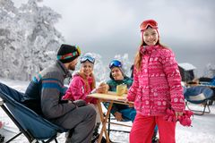 Portrait of girl with family enjoying winter vacation on snow. Smiling portrait of girl with family enjoying winter vacation on snow Royalty Free Stock Images