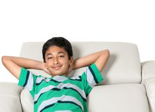 Free Smiling Portrait Of A Young Boy On A Couch Royalty Free Stock Photo - 116808605