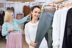 Smiling positive women shopping Royalty Free Stock Images
