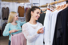 Smiling positive young women shopping Royalty Free Stock Image