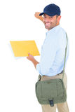 Smiling postman with letter knocking on white background Stock Images