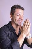 Smiling praying man Royalty Free Stock Photos