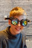 Boy with silly prism glasses stock image