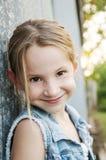 Smiling pre-teen in denim jacket Stock Photo