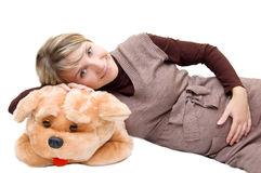 Smiling pregnant and big toy dog Royalty Free Stock Images
