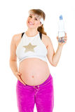 Smiling pregnant female holding bottle of water Royalty Free Stock Image