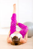 Smiling pregnant female making gymnastics at home Royalty Free Stock Photo