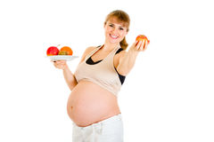Smiling pregnant holding fruits in hands Stock Photography