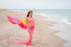 Smiling Pregnant Woman on the Beach Royalty Free Stock Photos