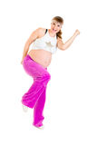 Smiling pregnant woman doing fitness exercises Stock Photos
