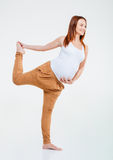 Smiling pregnant woman doing stretching exercise Royalty Free Stock Photo