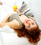 Smiling pregnant woman with glass of juice in hand Stock Photos