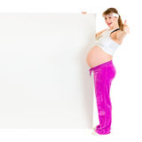 Smiling pregnant woman holding blank billboard Stock Images